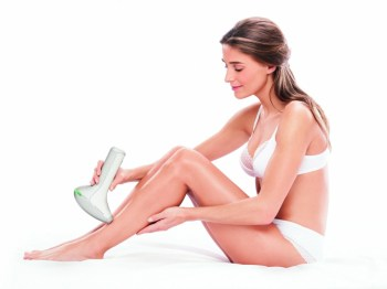Lady treating her legs with the Lumea Precision Plus.