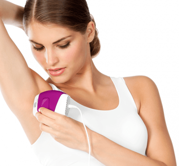 Lady treating her underarm with the Silk'n Glide 150,000