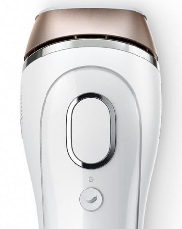 Top view of the silk-expert device showing the larger flash button and small 'feather' gentle mode button.