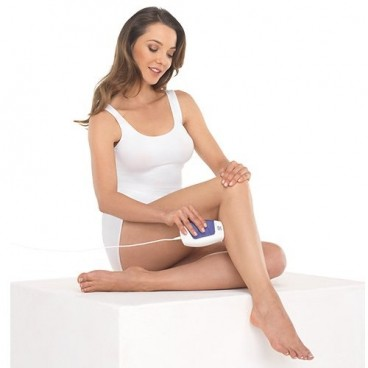 Lady sitting down and treating her leg with the Silk'n Glide xpress