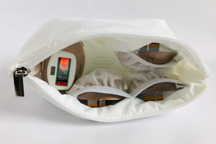 The zip-close white padded storage pouch protects the device and treatment windows