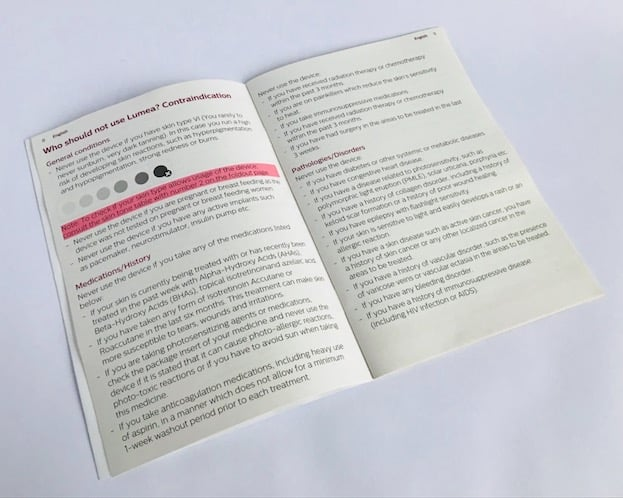 Photo of the Lumea Prestige user manual open at the contraindications page