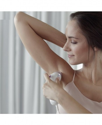 Lady treating her underarms with the silk expert 3 IPL