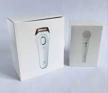 The Silk expert IPL and the Braun facial brush are housed in separate small white cardboard boxes.