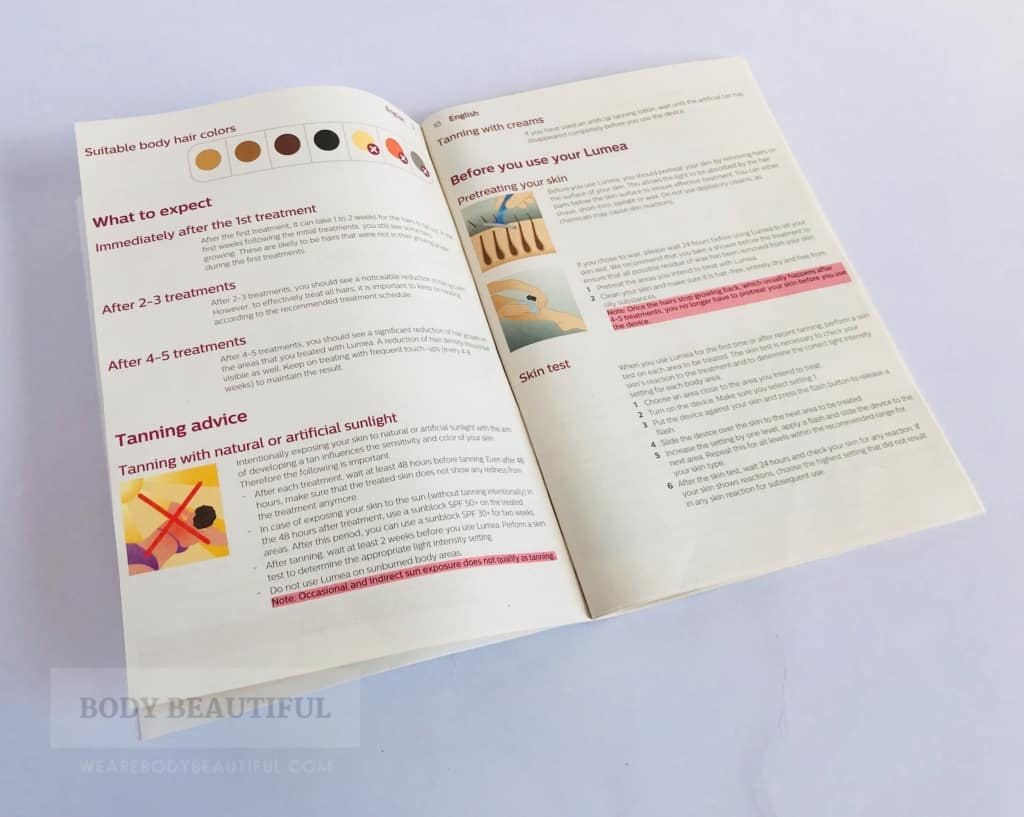 Phto of the Lumea Advanced user manual open at the skin tone suitability and tanning guidelines page