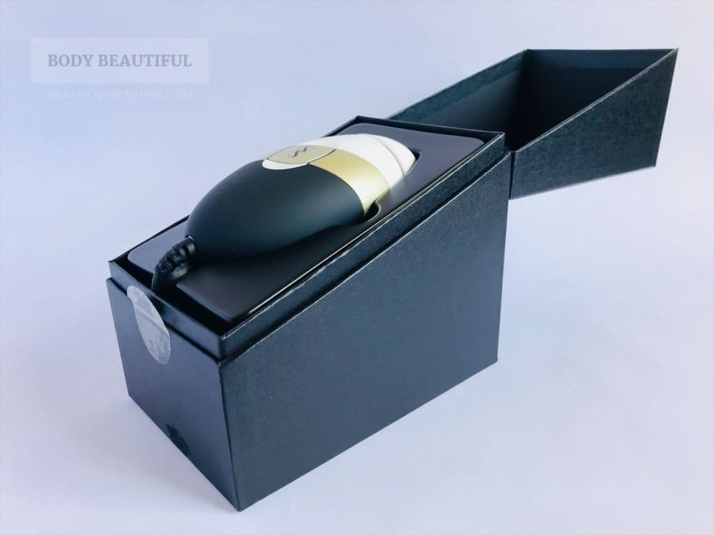 Photo showing the angled open lid of the sturdy SS Bare box with the small SS Bare device cradled inside.