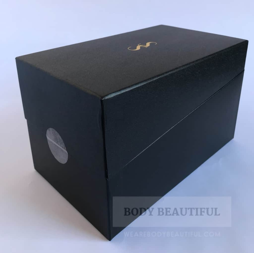 The small black smoothskin muse box with embossed gold interlinked 'SS' logo