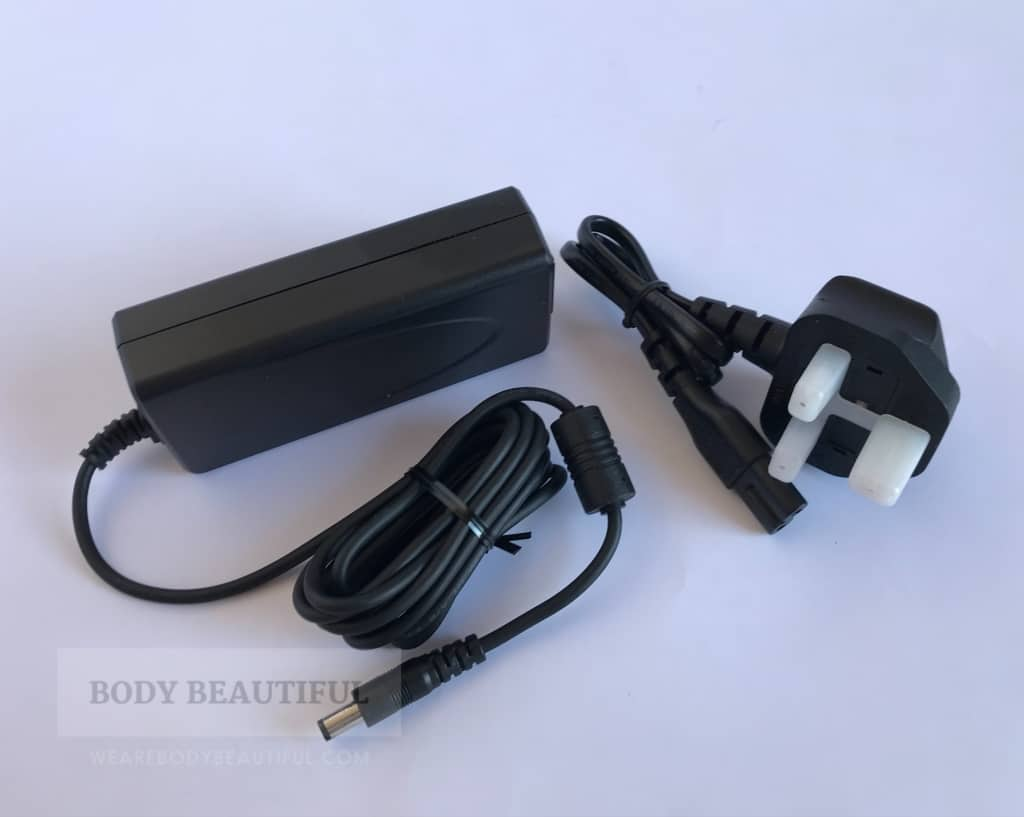 Photo of the black power pack and mains cable wound up straight from the box.