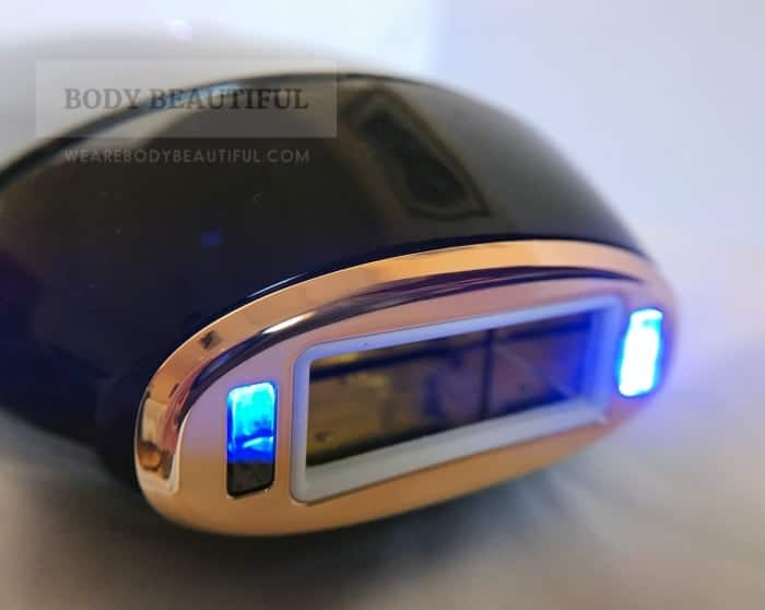 Close up of the Muse flash window with the skin tone sensors illuminated bright blue