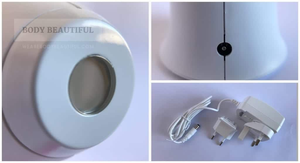 Close up of the Tria's small laser aperture, the charging cable inlet in the handle and the charging cable.