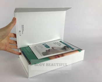 Photo of a hand opening the small white lid of the Mira-skin box.