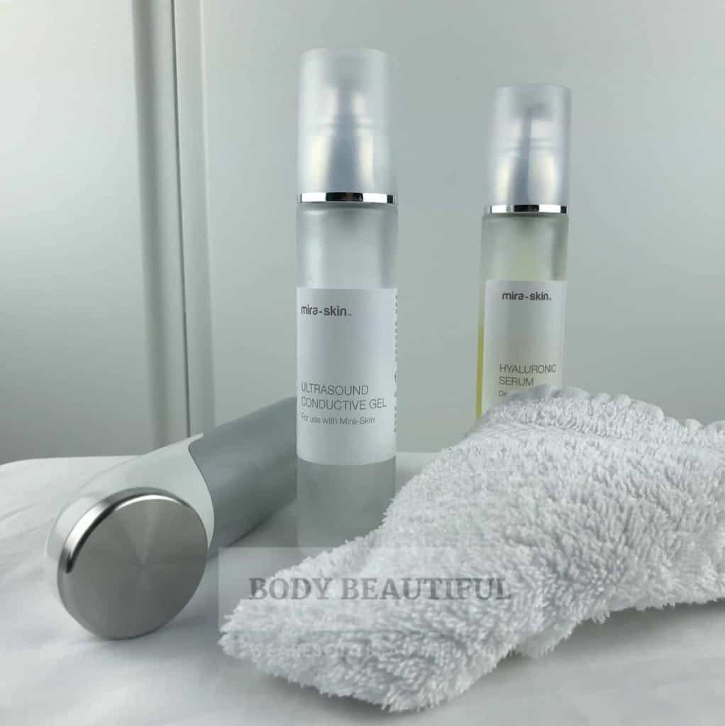 Photo of the ultrasound wand, bottle of gel and serum and a small towel to wipe your hands after applying gel to each section.