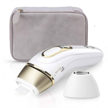 Photo of the white & gold Braun Pro IPL with body and precision attachments and grey storage pouch.