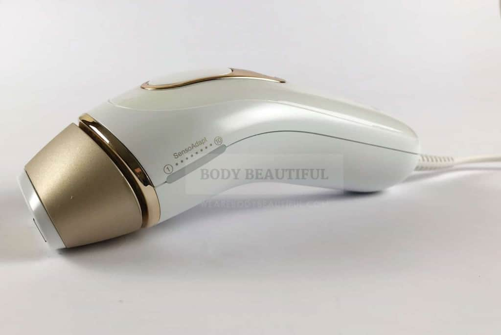 Angled side photo of the white and gold Braun Pro 5 IPL showing the subtle curves and clean design lines.