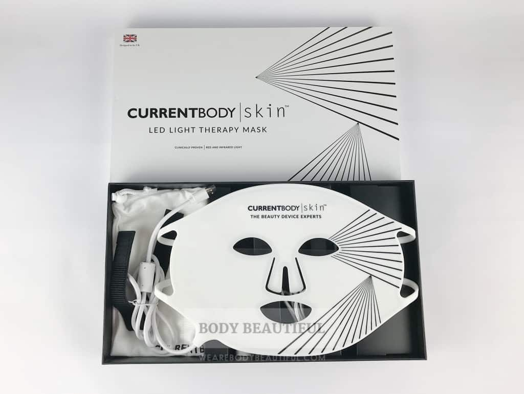 The white id removed from the  CurrentBody.com Skin LED light therapy mask box to reveal the white silicone mask.