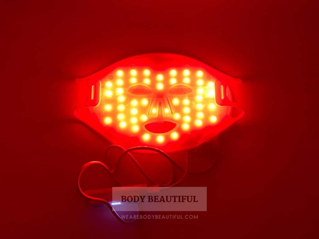 Photo taken of the CurrentBody.com Skin mask in darkness so the red LED lights shine bright