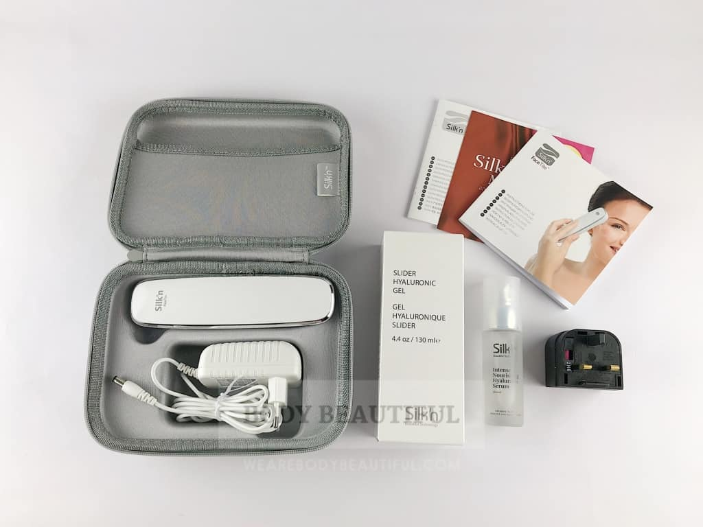 the full contents of the Silk'n FaceTite box: Silk'n FaceTite device, Mains cable & Euro plug, UK adaptor, Silver storage case, Slider gel, Hyaluronic serum, User guide, Warranty leaflet