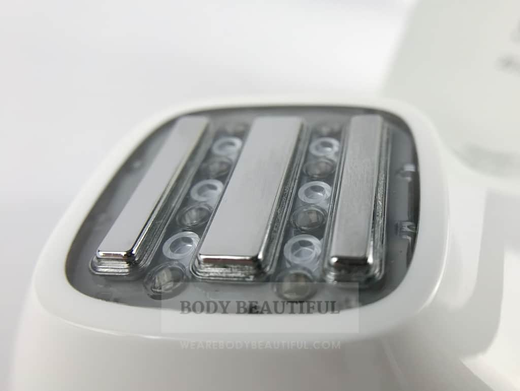 Close-up of the Silk'n FaceTite treatment head with 3 RF bars and 3 LED lights between each