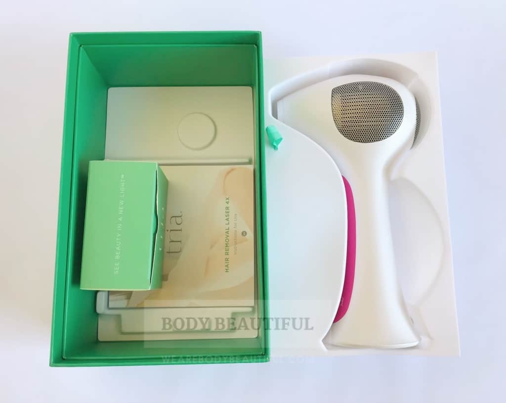 the small green box with charging cable inside, and small square user booklet are under the moulded bed.