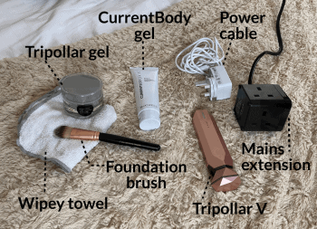 Tripollar or ~CurrentBody gel, foundation brush and wipey towel, power cable and mains extension, and the Tripollar V device.