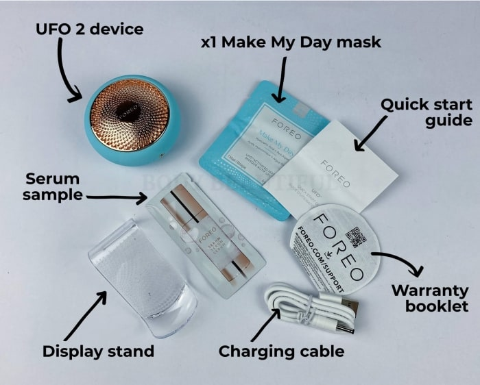 Inside the UFO 2 box: UFO 2 device, display stand, sample serum, x1 Make My Day Mask, Quick start guide, warranty booklet, charging cable.